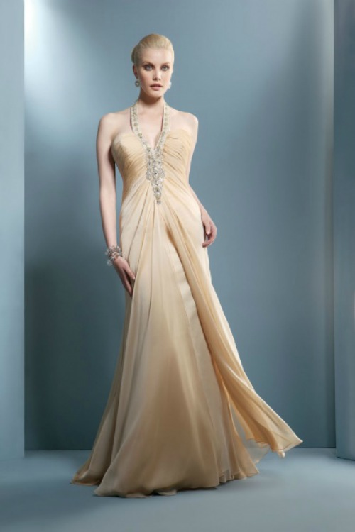 Long dress with jeweled neckline and fluid embedded. Collection Demetrios 2012